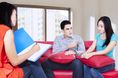 Young couple consults at the psychologist Royalty Free Stock Photos