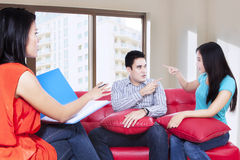 Young couple consults talking to psychologist 1 Stock Image