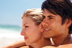 Young couple in a contemplative mood at the shore Royalty Free Stock Photography