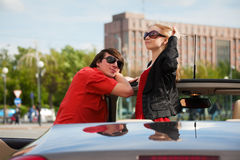 Young couple with a convertible car Stock Images