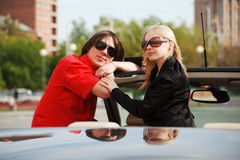 Happy young couple in a car Stock Photography
