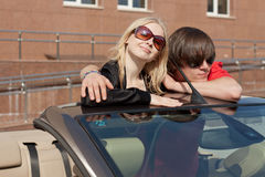 Young couple in a convertible car Royalty Free Stock Image
