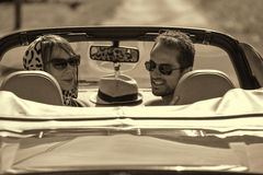 A young couple in a convertible car Stock Photography