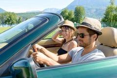 A young couple in a convertible car Royalty Free Stock Photos