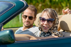 A young couple in a convertible car. A young couple in a green convertible car Royalty Free Stock Photography