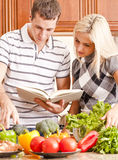 Young Couple Cooking Royalty Free Stock Photo