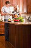 Young Couple Cooking Stock Photography