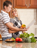 Young Couple Cooking Stock Photo