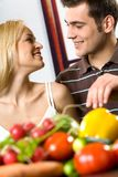Young couple cooking stock photos