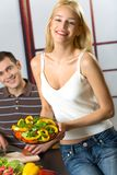 Young couple cooking Royalty Free Stock Image
