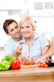 Young couple cooking breakfast together Stock Images