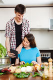 Young couple cooking with electronic book Royalty Free Stock Photos
