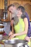 Young couple are cooking at home stock image