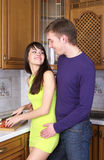 Young couple cooking at home Stock Photo