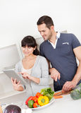 Young couple cooking at home Royalty Free Stock Photo