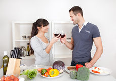 Young couple cooking at home Stock Photography