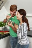 Young couple cooking in the kitchen Stock Images