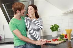 Young couple cooking in the kitchen Stock Photos
