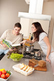 Young couple cooking in kitchen together Stock Image