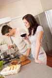 Young couple cooking in kitchen together Royalty Free Stock Photos
