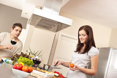 Young couple cooking in kitchen together Royalty Free Stock Image