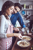 Young couple cooking. Man and woman in their kitchen Royalty Free Stock Photo