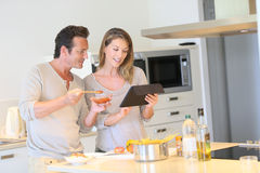 Young couple cooking meal together Stock Images