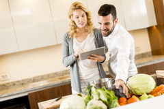 Young couple cooking in the modern kitchen Stock Photography