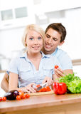 Young couple cooking salad together Stock Image