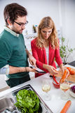 Young couple cooking together Royalty Free Stock Photography