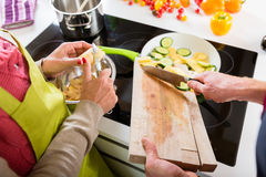 Young couple cooking together in kitchen Royalty Free Stock Photography