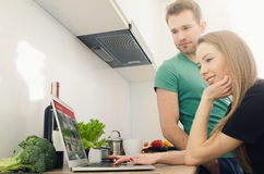 Young couple cooking together in the kitchen Royalty Free Stock Photography