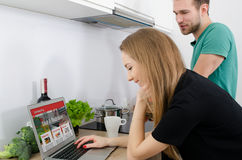 Young couple cooking together in the kitchen. Royalty Free Stock Images