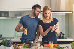 Young couple cooking together meal preparation indoor Stock Photos