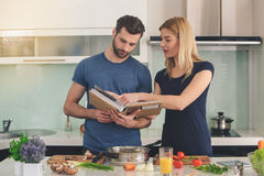Young couple cooking together meal preparation indoor Royalty Free Stock Photography