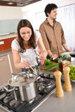 Young couple cooking together in modern kitchen Stock Photography