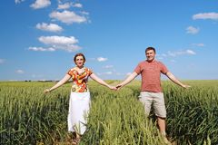 Young couple in cornfield Royalty Free Stock Photo