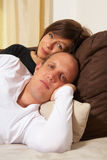 Young couple on the couch Royalty Free Stock Photo