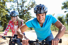 Young couple on country bike ride Stock Photo