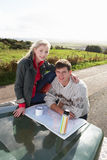 Young couple on country drive Royalty Free Stock Photo