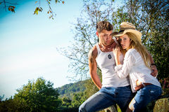 Young Couple in a country setting. Royalty Free Stock Images