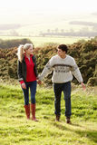Young couple on country walk stock images