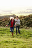 Young couple on country walk royalty free stock images
