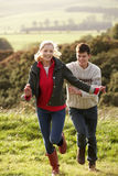 Young couple on country walk stock photo