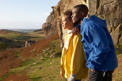 Young couple on country walk royalty free stock photos