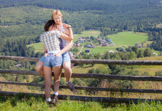 Young couple at countryside summer view. Young couple in love at countryside summer view Stock Photo