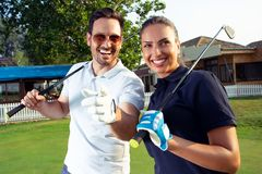Couple at the course playing golf and looking happy. Young Couple at the course playing golf and looking happy royalty free stock photos
