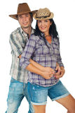 Young couple with cowboy's hats Royalty Free Stock Photography