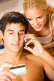 Young couple with credit card Stock Photography