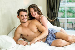 Young couple cuddling on bed Royalty Free Stock Images